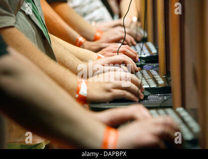 FILE - An archive picture dated 20 August 2009 shows computer gamers testing a game at the computer games fair Gamescom - Stock Photo