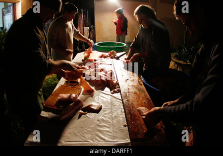 Different scenes from a traditional slaughter day in a village in the Spanish island of Majorca. - Stock Photo