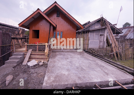 Balance (W.O.P) in Apatani dwelling houses -mixture on traditional architectural designs with modernity,clean environment. - Stock Photo