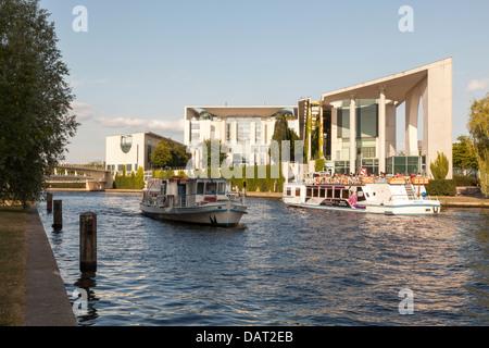 Bundeskanzleramt and River Spree with tourist boats, Berlin, Germany - Stock Photo