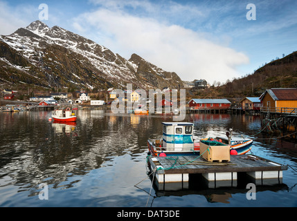 The pretty harbour at Mosknes on the Lofoten Islands, Norway with Merraflestinden in the background - Stock Photo