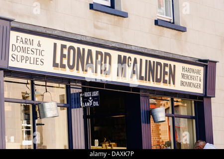 Old fashioned farm and domestic supplies shop owned by Leonard McAlinden, commonly found in Victorian Ireland - Stock Photo