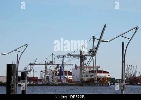 Lamps in the shape of dockside cranes in the HafenCity district of Hamburg, Germany. - Stock Photo