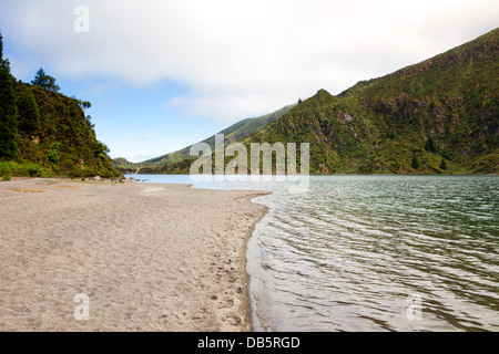 At the beach of Lagoa do Fogo, a volcano crater lake on the island of São Miguel, Azores - Stock Photo