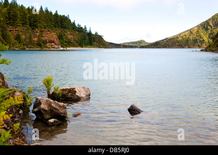 At the shore of Lagoa do Fogo, a volcano crater lake on the island of São Miguel, Azores - Stock Photo