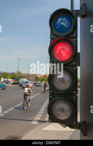 Traffic lights for cyclists; bicycle light turns red, a cyclist cross the street - Stock Photo