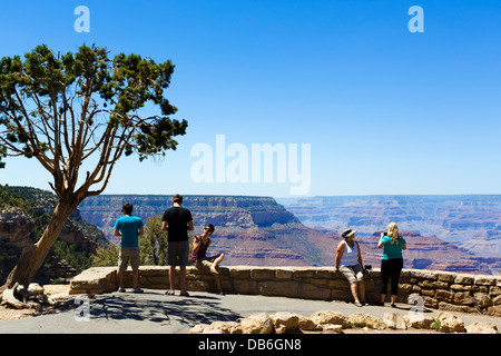 Tourists at the lookout at Grandview Point, South Rim, Grand Canyon National Park, Arizona, USA - Stock Photo