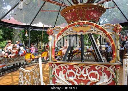 The bicycle carousel at Fete Paradiso, a collection of antique carousels and carnival rides on Governors Island - Stock Photo