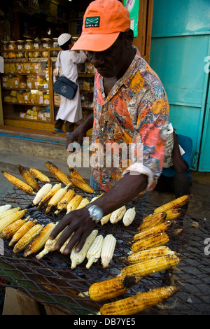 Food - corn corn on cob mealies street vendor barbecues corn in Stonetown in Zanzibar,Stone Town Zanzibar island - Stock Photo