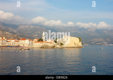 Panoramic view toward the old part of Budva in Montenegro, shot in the warm light of the late afternoon. - Stock Photo