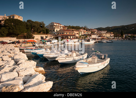 Boats moored at Kassiopi harbour in Corfu, Greece - Stock Photo