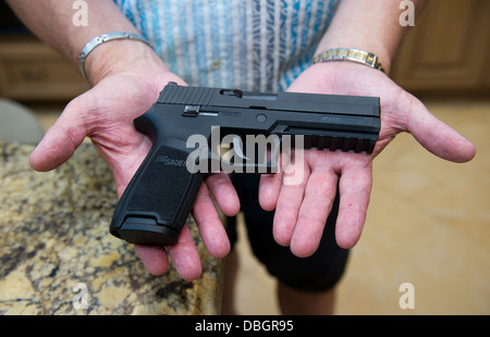 A Sig Sauer P250 gun being kept as a protection against intruders at a private home, Santa Ana, California - Stock Photo