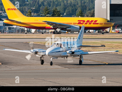 KD Air Piper PA-31-310 Navajo (C-GPCA) airplane taxies to the south terminal Vancouver International Airport, Canada. - Stock Photo