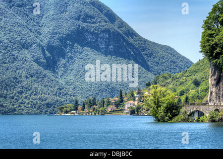 Lakeside landscape view at scenic lake Lugano in Italian Lago di Como district - Stock Photo