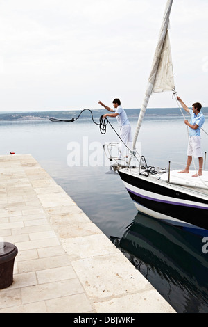 Croatia, Sailboat entering port, docking maneuver - Stock Photo