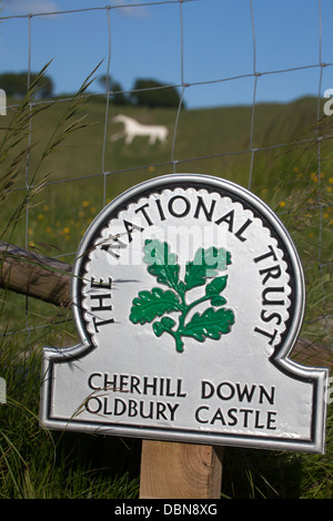 National Trust Sign at Cherhill Down Oldbury Castle with White Horse in Background - Stock Photo