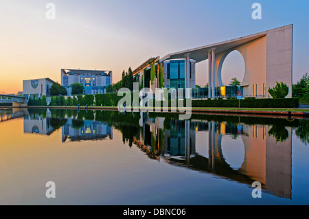 Bundeskanzleramt in Berlin, Germany, with reflection in Spree river at sunrise - Stock Photo