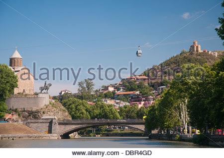 Metekhi Church with equestrian statue of King Vakhtang Gorgasali, standing above the Mtkvari River, Tbilisi - Stock Photo
