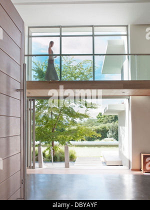 Woman on modern elevated walkway - Stock Photo