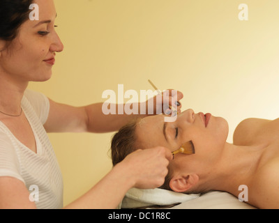 Young woman having face massage - Stock Photo