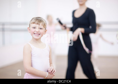 Portrait of mischievous young ballerina - Stock Photo