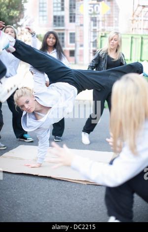 Girl breakdancing in playground - Stock Photo