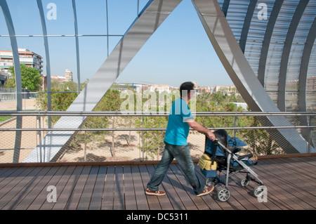 Man with his child at Perrault bridge. Madrid Rio park, Madrid, Spain. - Stock Photo