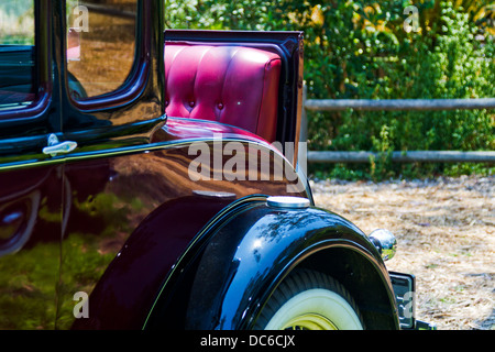 Closeup of rumble seat on a classic Model A Ford. - Stock Photo