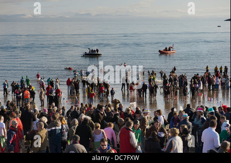 Abersoch, North Wales : New Years Day fund raising swim in aid of the Royal National Lifeboat Instituion [RNLI] - Stock Photo