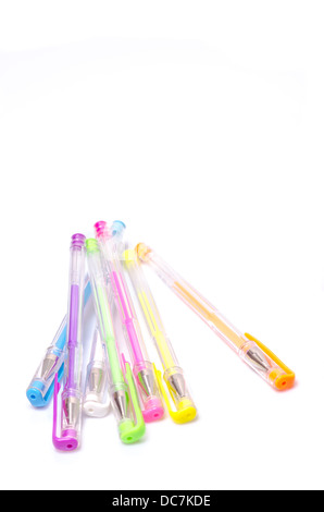Close-up of colored fluorescent ball point pens on white background - Stock Photo