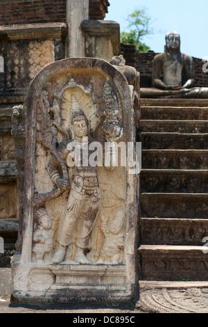 Ancient guard stone near entrance at Vatadage in Polonnaruwa, Sri Lanka - Stock Photo