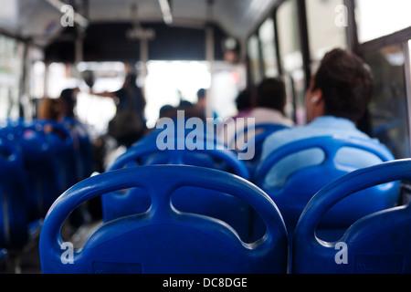 Passengers on a bus in Monterrey, Mexico. - Stock Photo