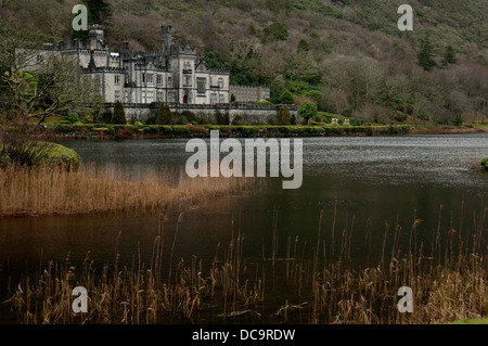 Kylemore Abbey (Irish: Mainistir na Coille Móire) is a Benedictine monastery founded in 1920 on the grounds of Kylemore - Stock Photo