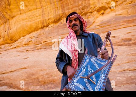 Bedouin playing a musical instrument Al Rababah, Wadi Rum, Jordan, Middle East - Stock Photo