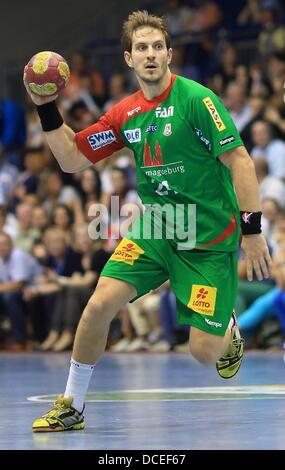 Magdeburg's Michael Haass has the ball during the handball test match between SCMagdeburg and Wisla Plock at Getec - Stock Photo