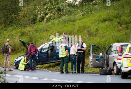 Somerset, near Bath, UK. Police and paramedics talking to the driver and passengers as Avon and Somerset Police - Stock Photo