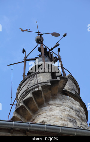 Bell tower with weather vane at the medieval city gate of Sommieres, Gard, France - Stock Photo