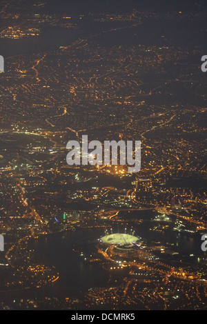 City of London (including 'The Dome' or O2 Arena) at night, as seen from a passenger airliner taking off from Heathrow - Stock Photo