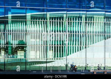 White steel columns of the Philharmonie concert hall reflected in the European Conference & Congress Centre in Luxembourg - Stock Photo
