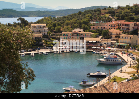 Boats in the harbour at Kassiopi seen from the hill above - Stock Photo