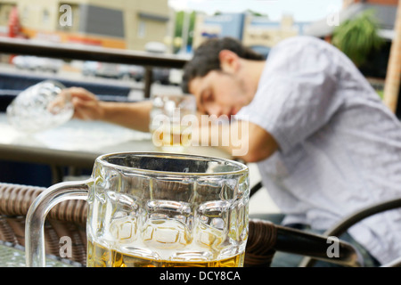Drunk young man shallow DOF - Stock Photo