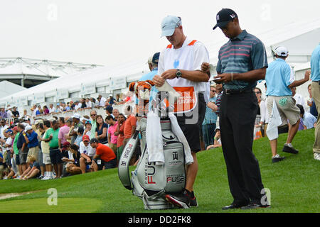 Jersey City, New Jersey, USA. 23rd Aug, 2013. August 23, 2013: Tiger Woods (USA) is in the rough during the the - Stock Photo