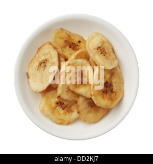 Dried banana chips in a bowl isolated on white background - Stock Photo