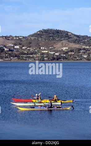 four women kayak on Richardson Bay from rentals in Sausalito - Stock Photo