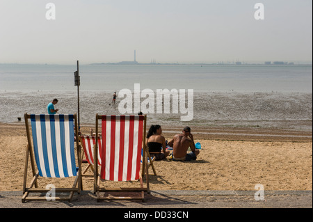 Two deck chairs on the beach. - Stock Photo
