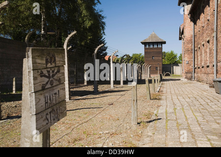 Barb Wire Fences And Guard Tower In The Auschwitz I Former Nazi Concentration Camp; Auschwitz, Poland - Stock Photo