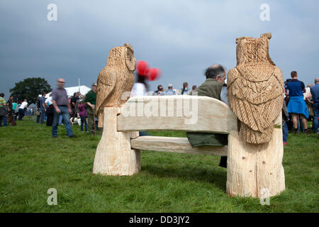 Cheshire Game & Country Fair, UK,  Aug 24 to Aug 26, 2013.  Chainsaw carved Owls; art figures at the 6th Tabley - Stock Photo