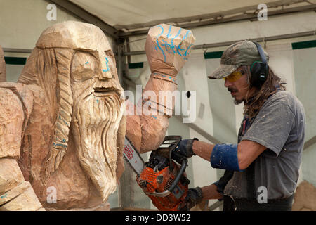 Tabley, Cheshire, UK 25th August, 2013. Viking figure carved by Bruce Thor from the USA at the 9th English Open - Stock Photo