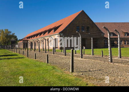 Barb Wire Fences And Buildings Inside The Auschwitz I Former Nazi Concentration Camp; Auschwitz, Poland - Stock Photo