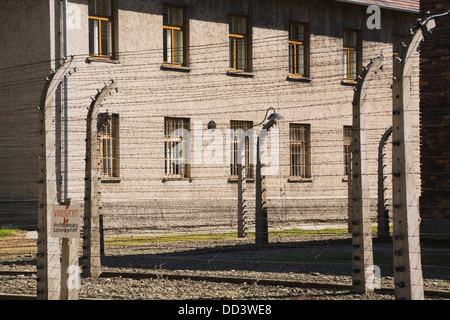 Barb Wire Fences And Building Inside The Auschwitz I Former Nazi Concentration Camp; Auschwitz, Poland - Stock Photo